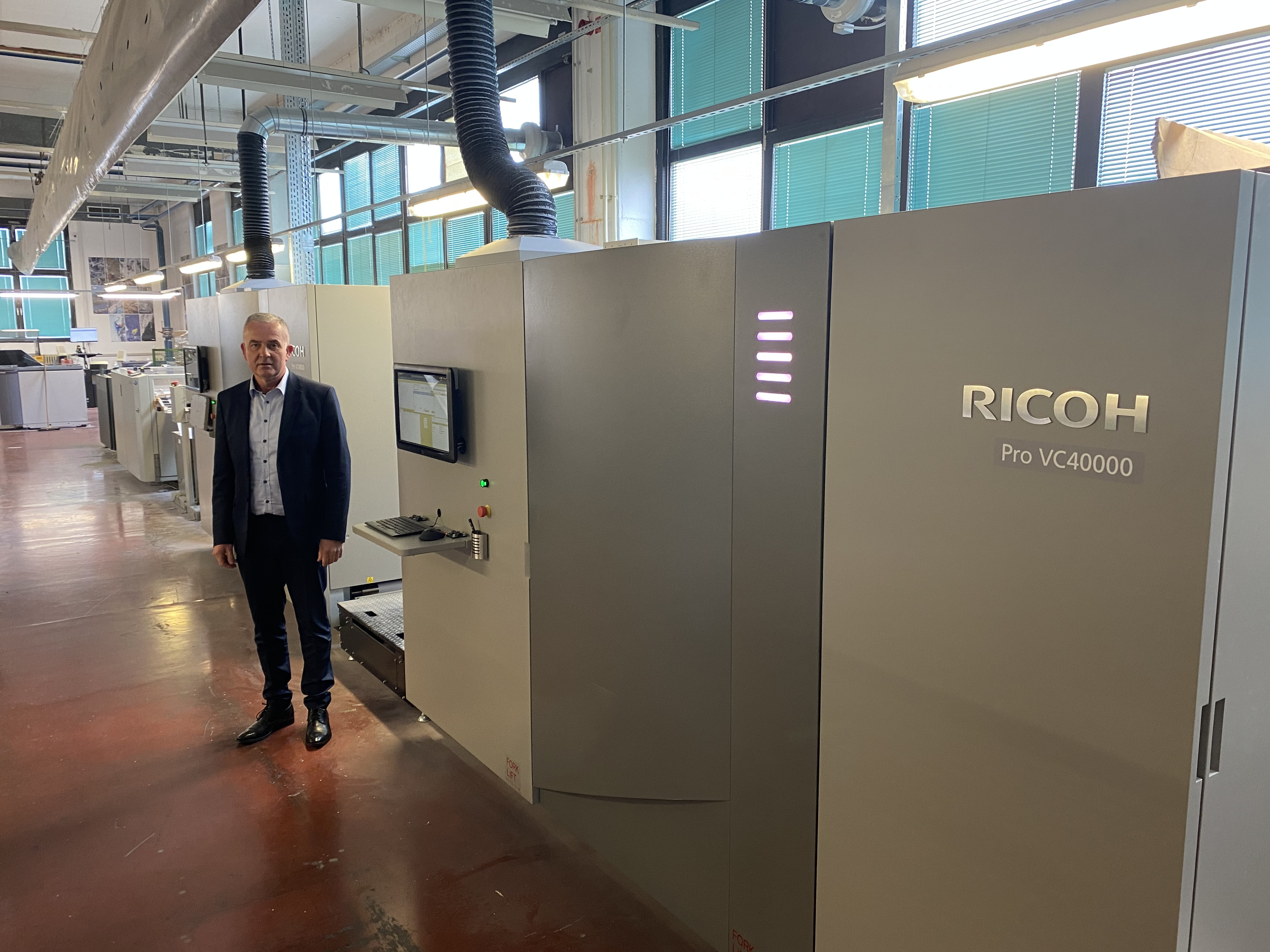 Slovenia Post expands into books, brochures and elevated production with two Ricoh Pro™ VC40000s